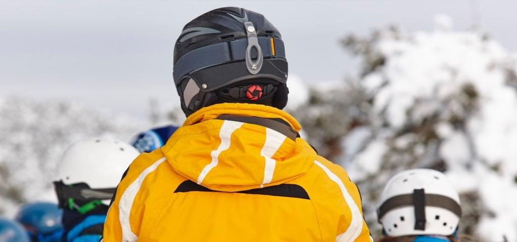 man wearing snow helmet from behind