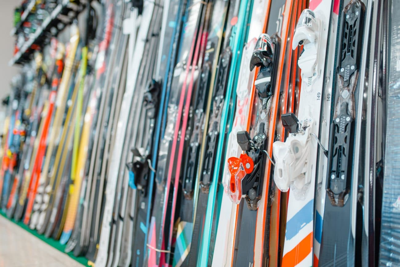 rows of skis in a ski sports shop