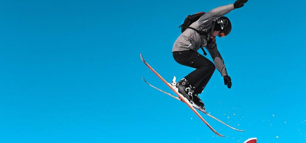 man doing tricks on all-mountain skis