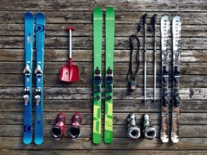 Ski equipment lined up on floor