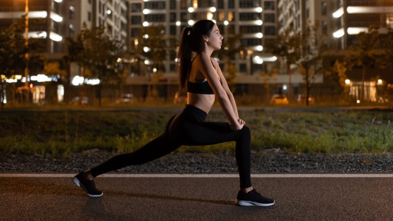 woman doing runners lunges at night