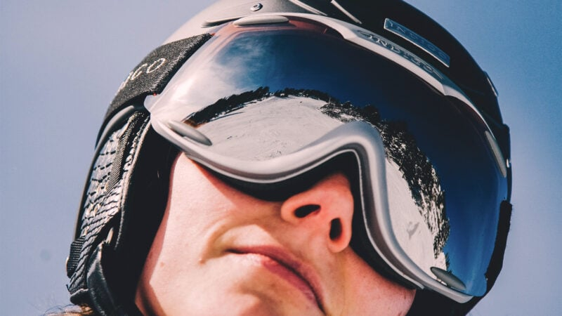 woman wearing ski helmet and goggles