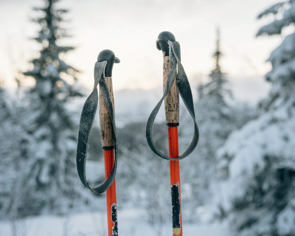 Close-up Of Ski Poles Hanging Against Sky