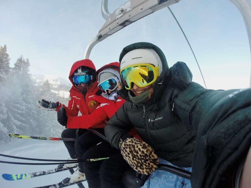 Group of friends taking a selfie on a ski lift