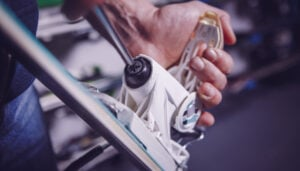 man showing how to adjust ski bindings