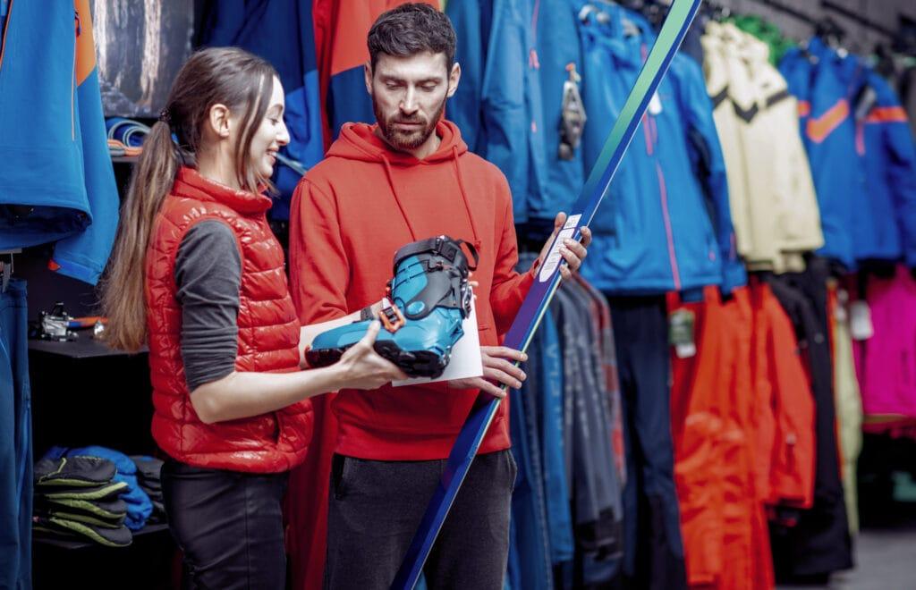 Man and woman choosing ski gear