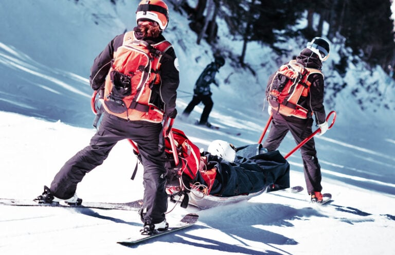 Ski patrol team rescue skier with skiing injury