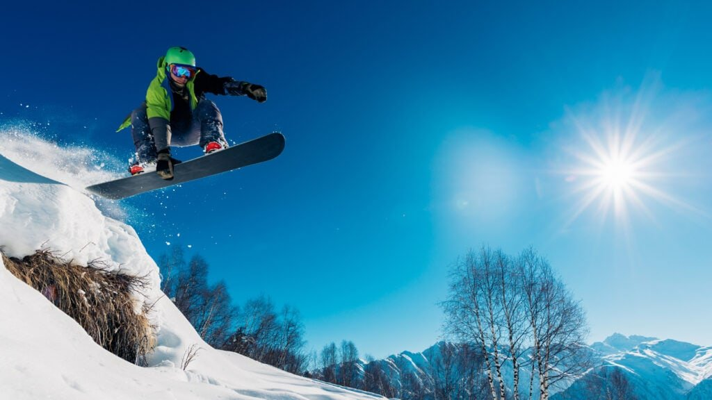 snowboarder jumping off-piste