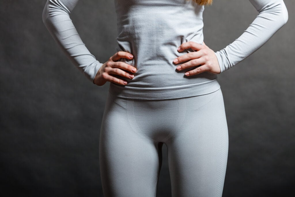 Fit woman in thermolinen base layer snow underwear