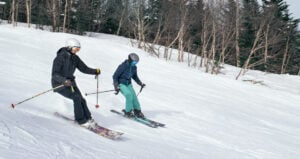 two women practicing parallel skiing technique